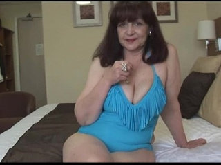 Attractive big tits mature lady in tight swimsuit playing on fitness ball | big titsfitnessladymaturetight